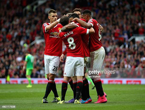 Memphis Depay of Manchester United celebrates scoring his team's first goal with his team mates during the Barclays Premier League match between...