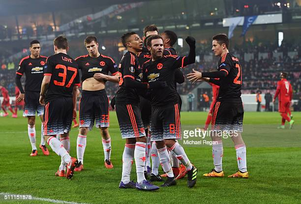 Memphis Depay of Manchester United celebrates scoring his team's first goal with his team mates during the UEFA Europa League round of 32 first leg...