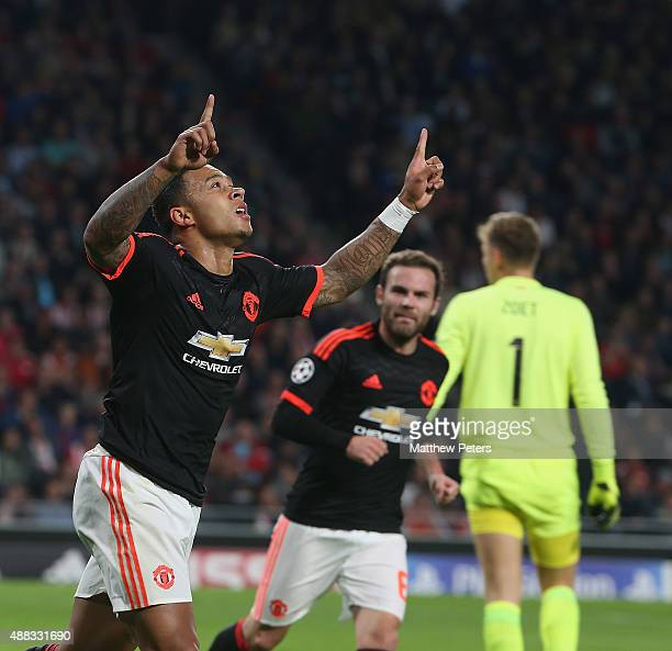 Memphis Depay of Manchester United celebrates scoring their first goal during the UEFA Champions League match between PSV Eindhoven and Manchester...