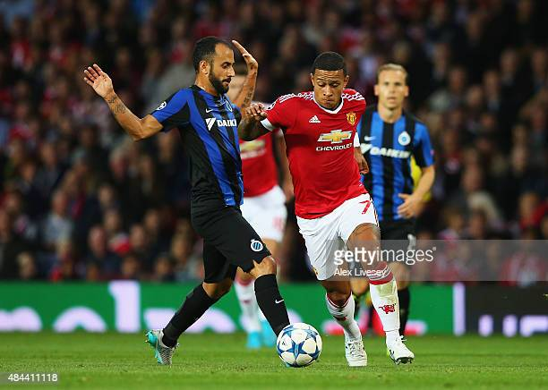 Memphis Depay of Manchester United goes past Victor Vazquez of Club Brugge during the UEFA Champions League Qualifying Round Play Off First Leg match...