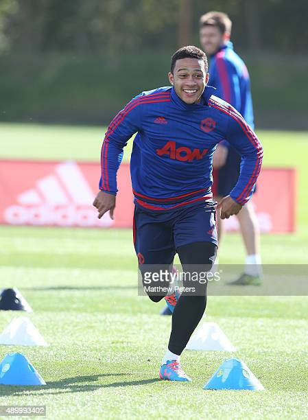 Memphis Depay of Manchester United in action during a first team training session at Aon Training Complex on September 25 2015 in Manchester England