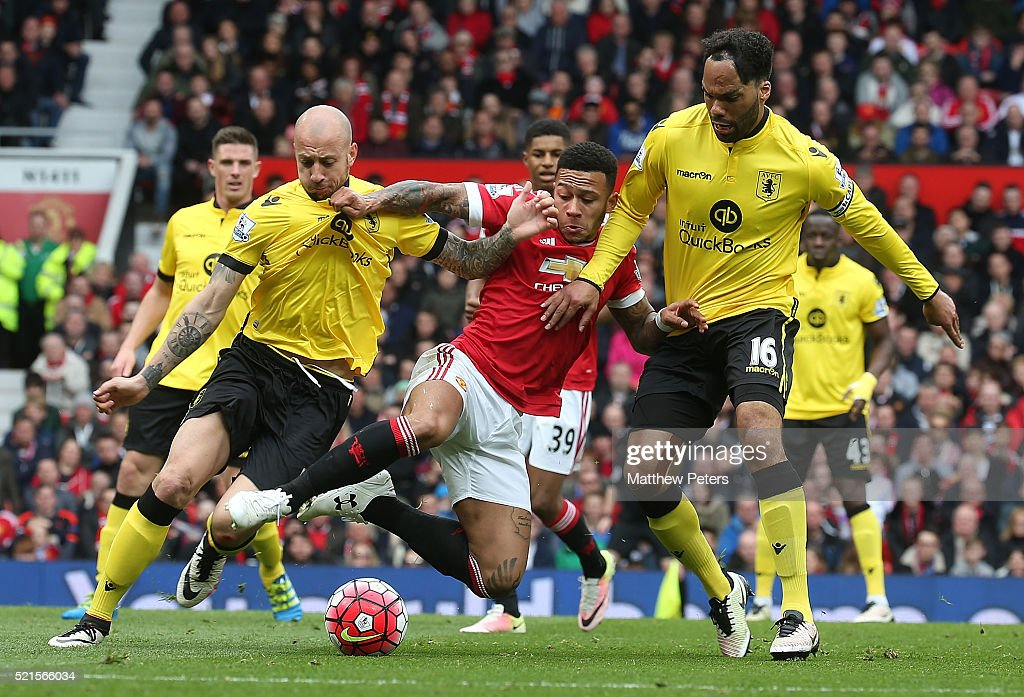 <a gi-track='captionPersonalityLinkClicked' href=/galleries/search?phrase=Memphis+Depay&family=editorial&specificpeople=7189987 ng-click='$event.stopPropagation()'>Memphis Depay</a> of Manchester United in action with <a gi-track='captionPersonalityLinkClicked' href=/galleries/search?phrase=Alan+Hutton&family=editorial&specificpeople=839355 ng-click='$event.stopPropagation()'>Alan Hutton</a> and <a gi-track='captionPersonalityLinkClicked' href=/galleries/search?phrase=Joleon+Lescott&family=editorial&specificpeople=687246 ng-click='$event.stopPropagation()'>Joleon Lescott</a> of Aston Villa during the Barclays Premier League match between Manchester United and Aston Villa at Old Trafford on April 16, 2016 in Manchester, United Kingdom.