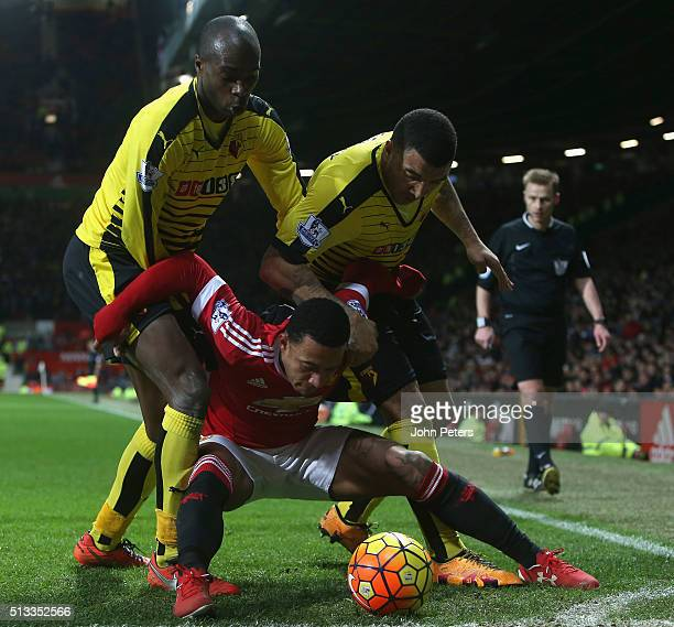Memphis Depay of Manchester United in action with Allan Nyom and Troy Deeney of Watford during the Barclays Premier League match between Manchester...