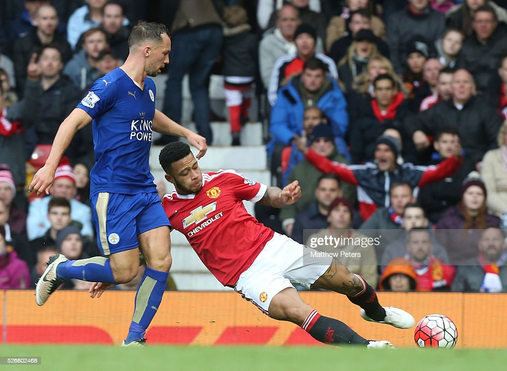 <a gi-track='captionPersonalityLinkClicked' href=/galleries/search?phrase=Memphis+Depay&family=editorial&specificpeople=7189987 ng-click='$event.stopPropagation()'>Memphis Depay</a> of Manchester United in action with <a gi-track='captionPersonalityLinkClicked' href=/galleries/search?phrase=Danny+Drinkwater&family=editorial&specificpeople=4224396 ng-click='$event.stopPropagation()'>Danny Drinkwater</a> of Leicester City during the Barclays Premier League match between Manchester United and Leicester City at Old Trafford on May 1, 2016 in Manchester, England.