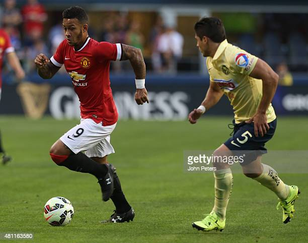 Memphis Depay of Manchester United in action with Javier Guemez of Club America during the International Champions Cup 2015 match between Manchester...