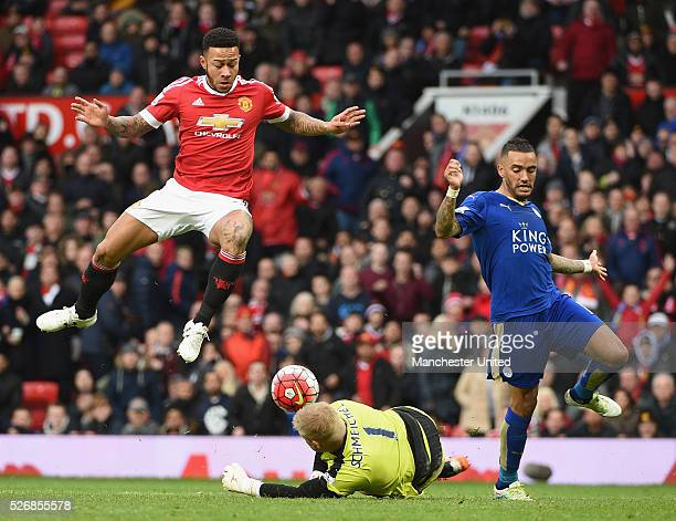 Memphis Depay of Manchester United in action with Kasper Schmeichel of Leicester City during the Barclays Premier League match between Manchester...
