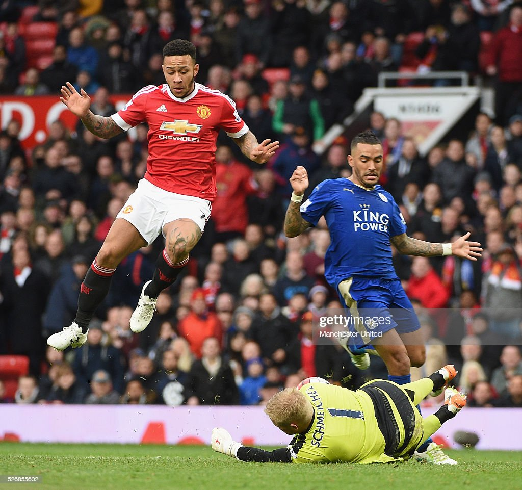 Memphis Depay of Manchester United in action with Kasper Schmeichel of Leicester City during the Barclays Premier League match between Manchester United and Leicester City at Old Trafford on May 1, 2016 in Manchester, England.