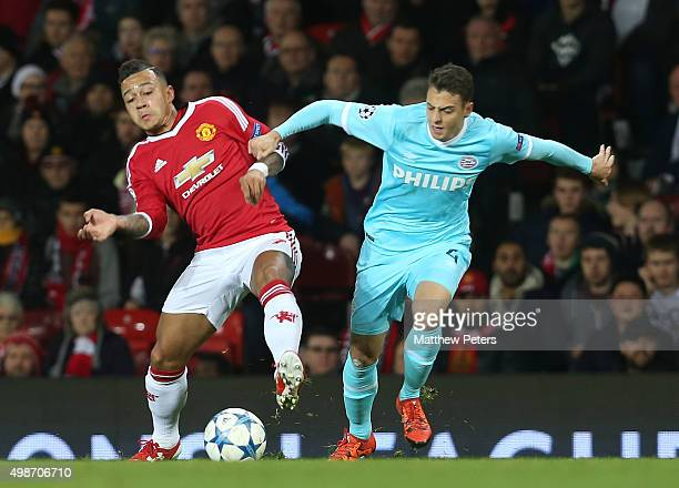 Memphis Depay of Manchester United in action with Santiago Arias of PSV Eindhoven during the UEFA Champions League match between Manchester United...