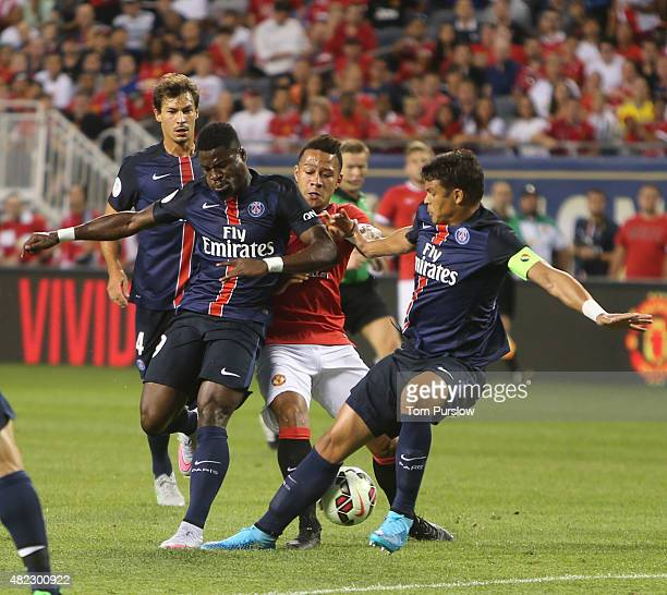 Memphis Depay of Manchester United in action with Serge Aurier and Thiago Silva of Paris Saint Germain during the International Champions Cup 2015...