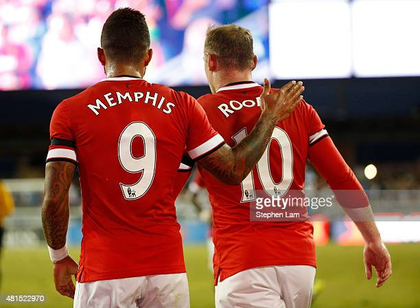 Memphis Depay of Manchester United is congratulated by teammate Wayne Rooney after scoring against the San Jose Earthquakes during the first half of...