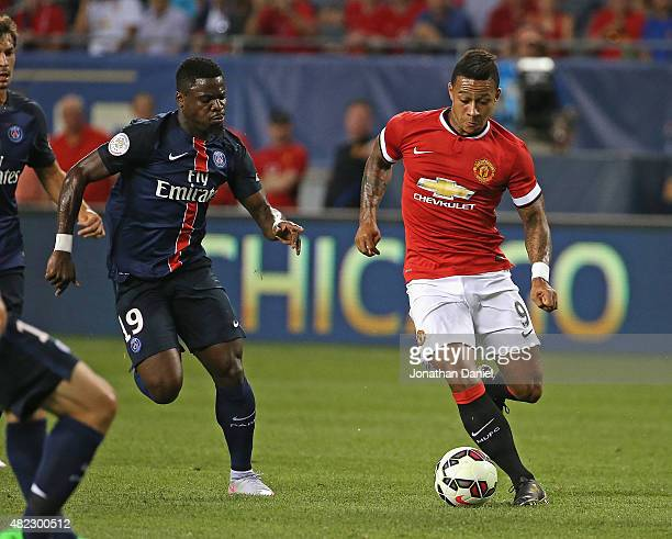 Memphis DePay of Manchester United moves past Serge Aurier of Paris SaintGermain during a match in the 2015 International Champions Cup at Soldier...