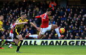 Memphis Depay of Manchester United scores his team's first goal during the Barclays Premier League match between Watford and Manchester United at...