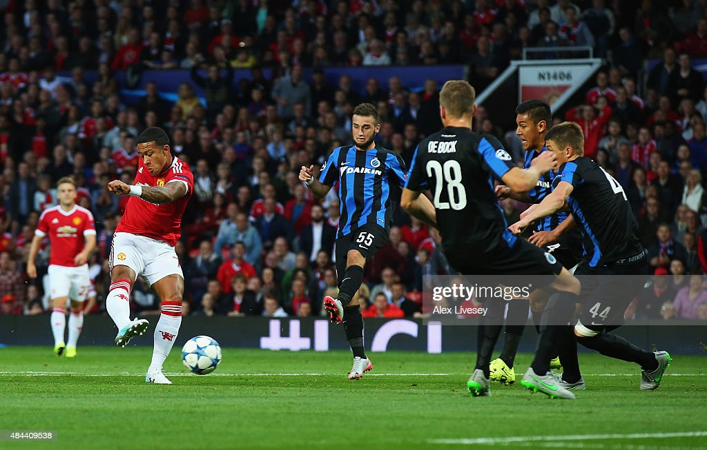 Memphis Depay of Manchester United scores his team's opening goal during the UEFA Champions League Qualifying Round Play Off First Leg match between...