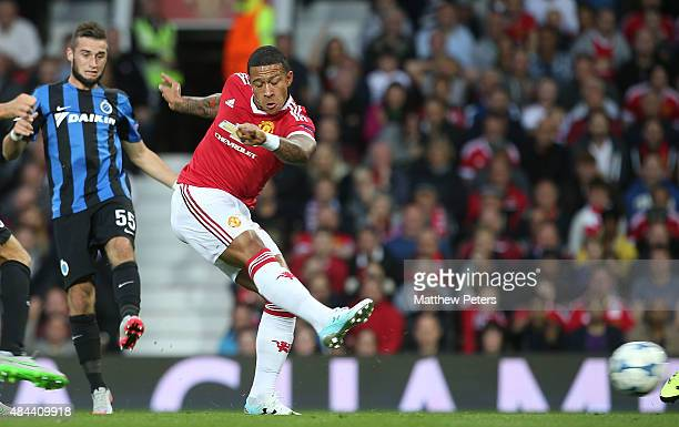 Memphis Depay of Manchester United scores their first goal during the UEFA Champions League playoff first leg match between Manchester United and...