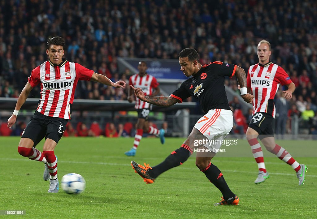 Memphis Depay of Manchester United scores their first goal during the UEFA Champions League match between PSV Eindhoven and Manchester United at...
