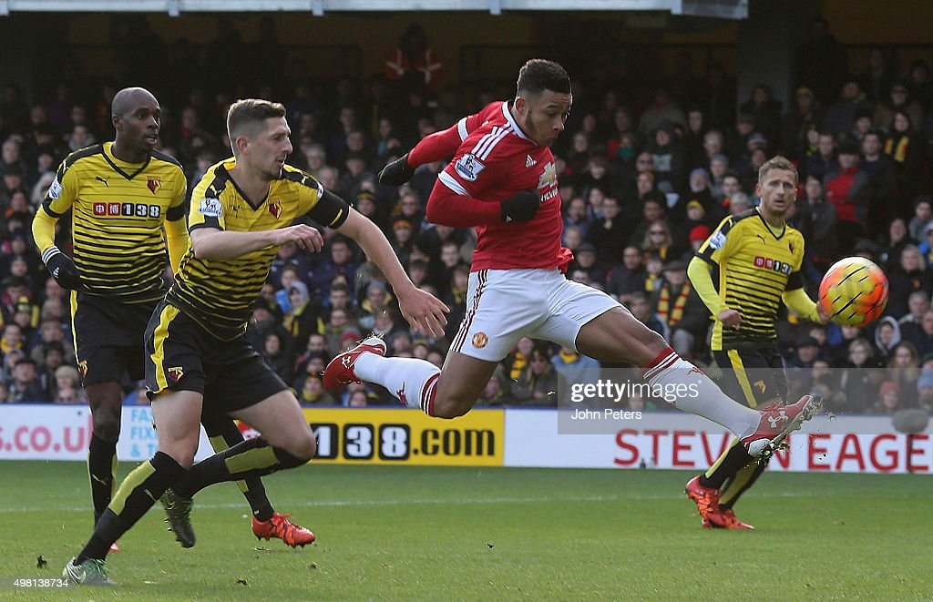 Memphis Depay of Manchester United scores their first goal during the Barclays Premier League match between Watford and Manchester United at Vicarage Road on November 21, 2015 in Watford, England.