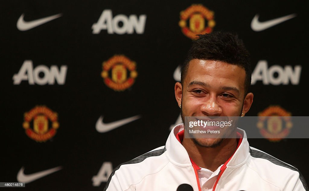 Memphis Depay of Manchester United speaks during a press conference to announce his signing at Old Trafford on July 10 2015 in Manchester England