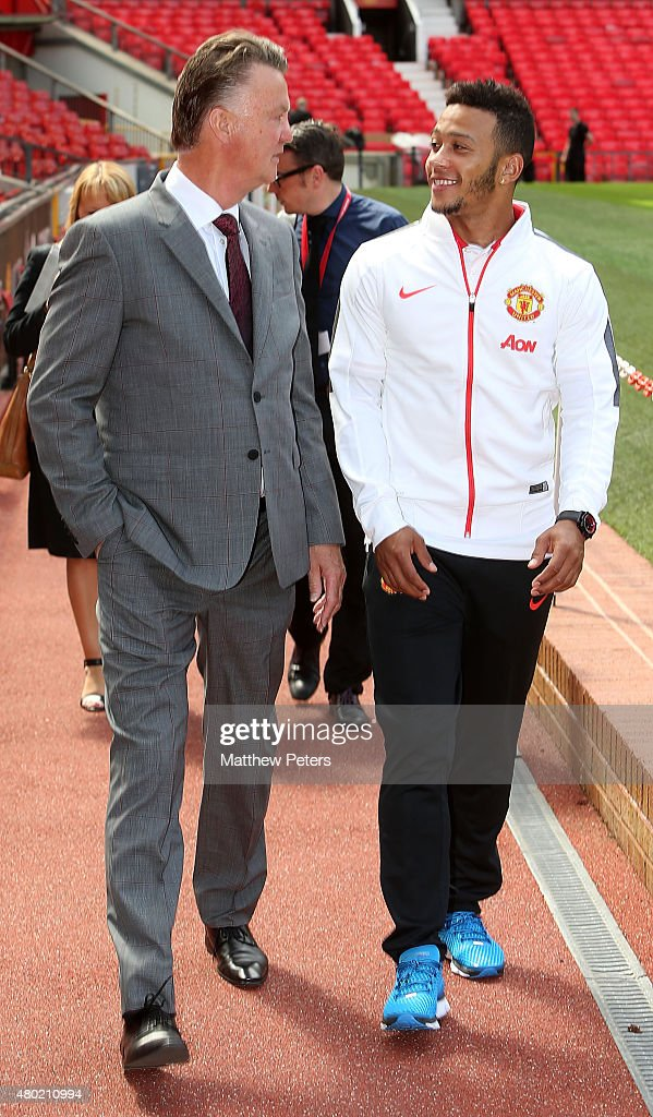 Memphis Depay of Manchester United talks with manager Louis van Gaal ahead of a press conference to announce his signing at Old Trafford on July 10...