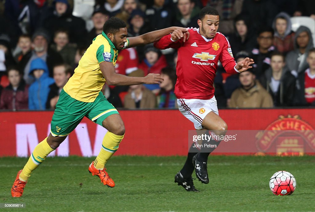 <a gi-track='captionPersonalityLinkClicked' href=/galleries/search?phrase=Memphis+Depay&family=editorial&specificpeople=7189987 ng-click='$event.stopPropagation()'>Memphis Depay</a> of Manchester United U21s in action with Reece Hall-Johnson of Norwich City U21s during the U21 Premier League match between Manchester United U21s and Norwich City U21s at Old Trafford on February 8, 2016 in Manchester, England.
