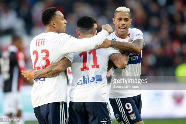 Memphis Depay of Olympique Lyon celebrates 04 with Kenny Tete of Olympique Lyon Mariano Diaz of Olympique Lyon during the French League 1 match...