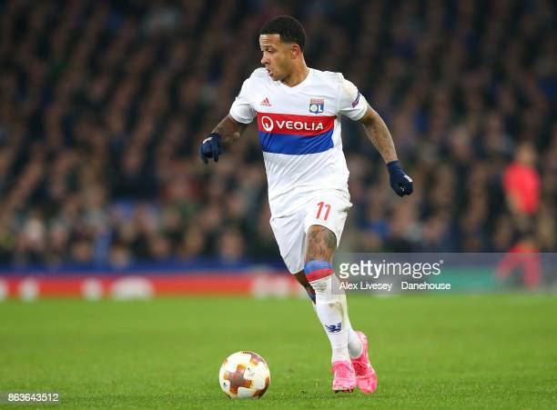 Memphis Depay of Olympique Lyon runs with the ball during the UEFA Europa League group E match between Everton FC and Olympique Lyon at Goodison Park...
