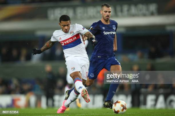 Memphis Depay of Olympique Lyonnais and Morgan Schnneiderlin of Everton during the UEFA Europa League group E match between Everton FC and Olympique...