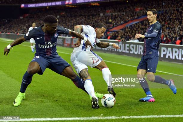 Memphis Depay of Olympique Lyonnais and Serge Aurier of Paris SaintGermain fight for the ball during the French Ligue 1 match between Paris Saint...