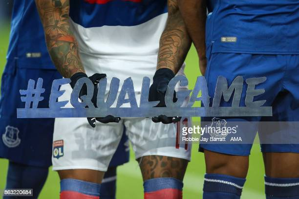 Memphis Depay of Olympique Lyonnais holds a message which reads Equal Game during the UEFA Europa League group E match between Everton FC and...