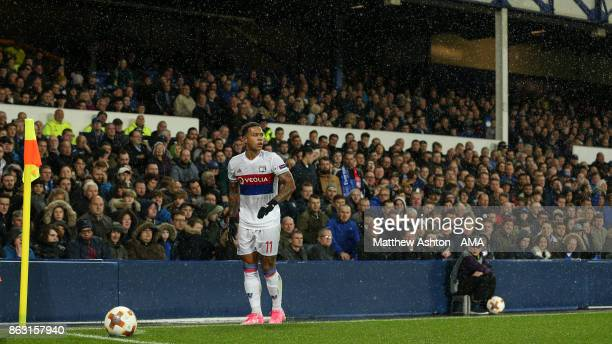 Memphis Depay of Olympique Lyonnais takes a corner during the UEFA Europa League group E match between Everton FC and Olympique Lyon at Goodison Park...