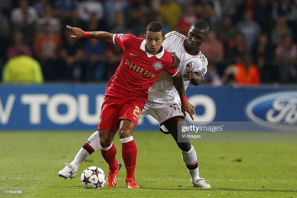 , Memphis Depay of PSV, Cristian Zapata of AC Milan during the Champions League qualifier match between PSV and AC Milan at Philips stadium on August 20, 2013 in Eindhoven, The Netherlands.