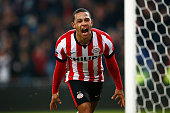 Memphis Depay of PSV Eindhoven celebrates scoring his teams winning goal in the final minute of the game during the Eredivisie match between PSV...
