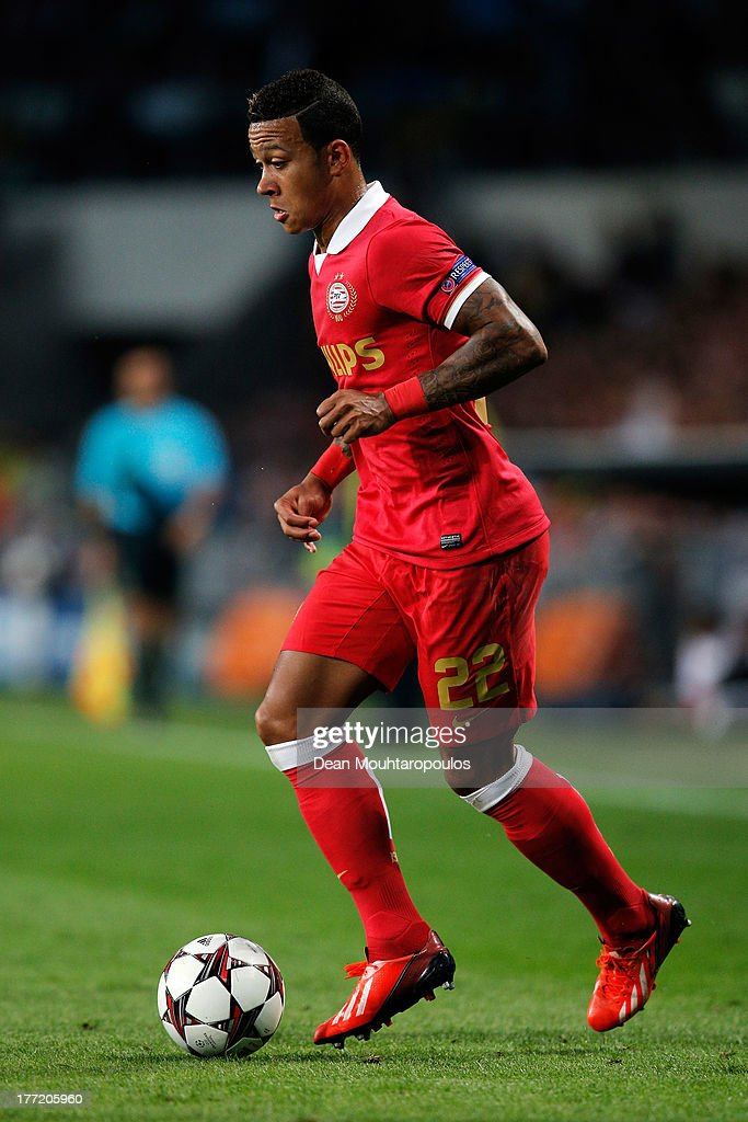 Memphis Depay of PSV in action during the UEFA Champions League Play-off First Leg match between PSV Eindhoven and AC Milan at PSV Stadion on August 20, 2013 in Eindhoven, Netherlands.