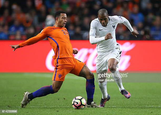 Memphis Depay of the Netherlands and Djibril Sidibe of France in action during the FIFA 2018 World Cup Qualifier between The Netherlands and France...