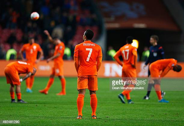 Memphis Depay of the Netherlands and team mates look dejected in defeat after the UEFA EURO 2016 qualifying Group A match between the Netherlands and...