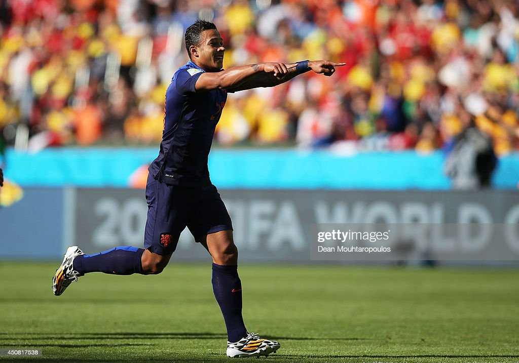 Memphis Depay of the Netherlands celebrates scoring his team's third goal during the 2014 FIFA World Cup Brazil Group B match between Australia and...