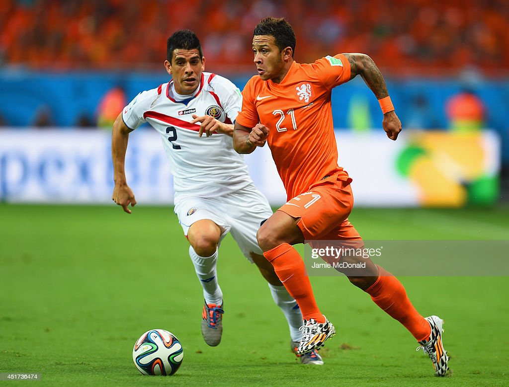Memphis Depay of the Netherlands controls the ball against Johnny Acosta of Costa Rica during the 2014 FIFA World Cup Brazil Quarter Final match...