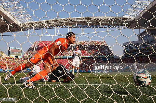 Memphis Depay of the Netherlands shoots and scores his team's second goal past goalkeeper Claudio Bravo of Chile during the 2014 FIFA World Cup...