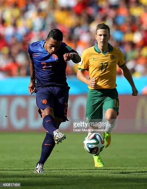 Memphis Depay of the Netherlands shoots and scores his team's third goal during the 2014 FIFA World Cup Brazil Group B match between Australia and...