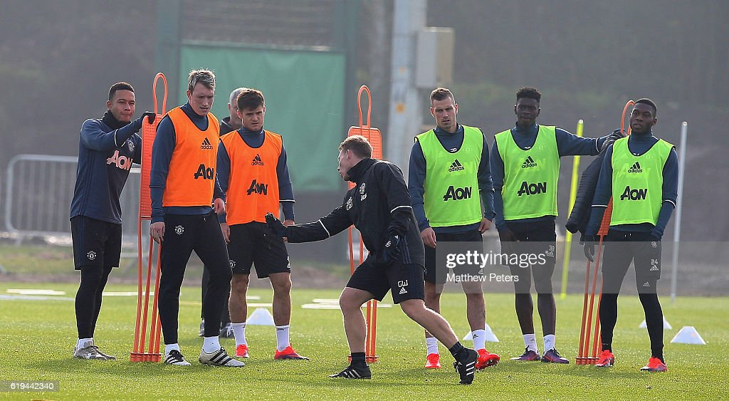 Memphis Depay, Phil Jones, Joe Riley, Morgan Schneiderlin, Axel Tuanzebe and Timothy Fosu-Mensah of Manchester United in action during a first team training session at Aon Training Complex on October 31, 2016 in Manchester, England.