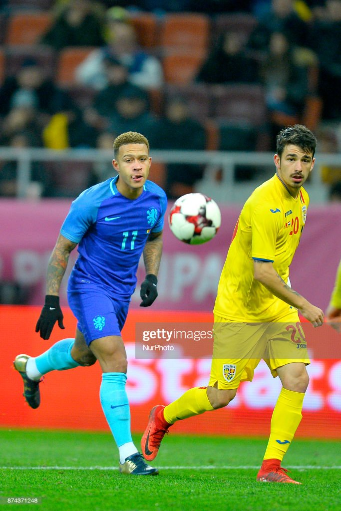Memphis Depay (Ned) vies Segiu Hanca (Rom) during the International Friendly match between Romania and Netherlands at National Arena Stadium in Bucharest, Romania, on 14 november 2017.