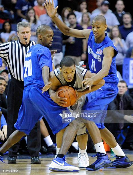 Memphis forward Robert Dozier and Georgetown guard Chris Wright squeezes out of a tight double team by Memphis defenders Doneal Mack and Wesley...