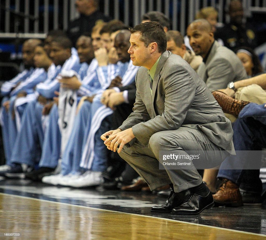 Memphis Grizzlies coach David Joerger watches during first-half action of a preseason game against the Orlando Magic at the Amway Center in Orlando, Florida, Friday, October 18, 2013. The Grizzlies defeated the Magic, 97-91.