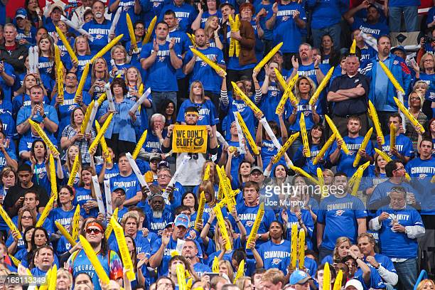 Memphis Grizzlies fan cheers amongst Oklahoma City Thunder fans as the teams play in Game One of the Western Conference Semifinals during the 2013...