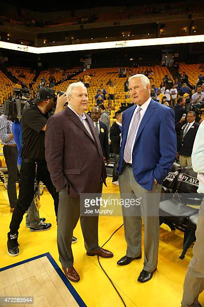 Memphis Grizzlies general manager Chris Wallace talks with NBA Hall of Famer Jerry West before Game Two of the Western Conference Semifinals between...