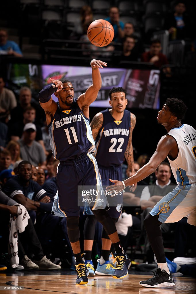 Memphis Grizzlies guard Mike Conley (11) passes off as Denver Nuggets guard <a gi-track='captionPersonalityLinkClicked' href=/galleries/search?phrase=Emmanuel+Mudiay&family=editorial&specificpeople=9510824 ng-click='$event.stopPropagation()'>Emmanuel Mudiay</a> (0) defends on the play February 29, 2016 at Pepsi Center.