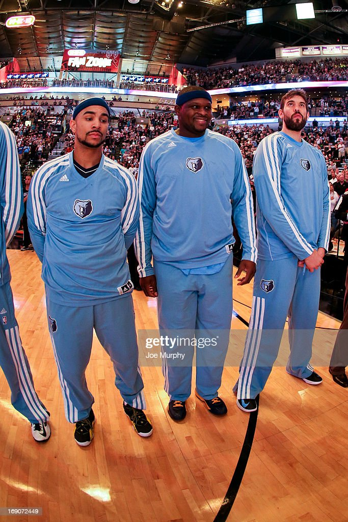 Memphis Grizzlies players, from right, Marc Gasol #33, Zach Randolph #50 and Jerryd Bayless #7 listen to the National Anthem before playing against the San Antonio Spurs in Game One of the Western Conference Finals during the 2013 NBA Playoffs on May 19, 2013 at the AT&T Center in San Antonio, Texas.