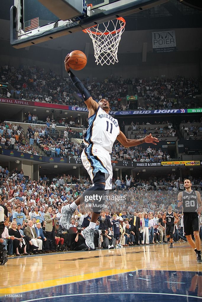 Memphis Grizzlies point guard Mike Conley #11 goes to the basket during an action against the San Antonio Spurs in Game Six of the Western Conference Quarterfinals in the 2011 NBA Playoffs on April 29, 2011 at FedExForum in Memphis, Tennessee. The Grizzlies won 99-91.
