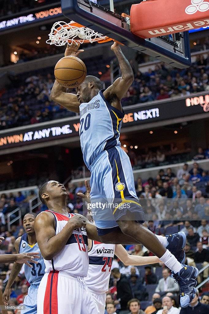 Memphis Grizzlies small forward Quincy Pondexter (20) slam dunks over Washington Wizards power forward Kevin Seraphin (13) during the first half of their game played at the Verizon Center in Washington, D.C., Monday, March 25, 2013.