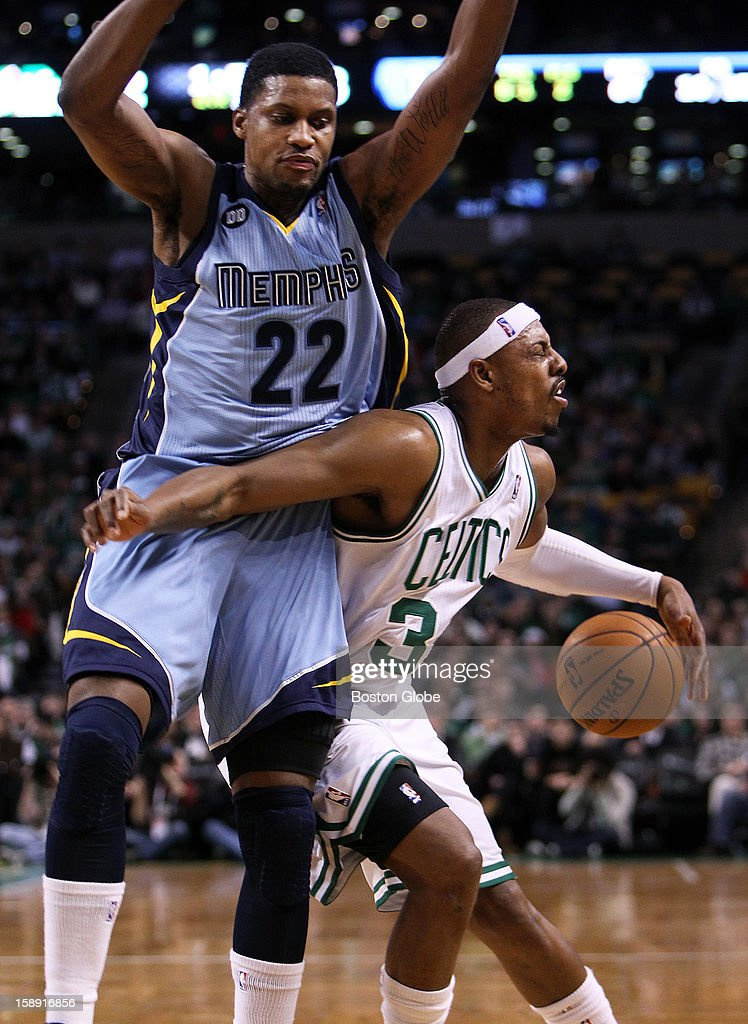 Memphis' Rudy Gay (#22), left, comes down hard on the Celtics' Paul Pierce as he commits a second quarter foul as the Boston Celtics hosted the Memphis Grizzlies in a regular season NBA game at TD Garden.