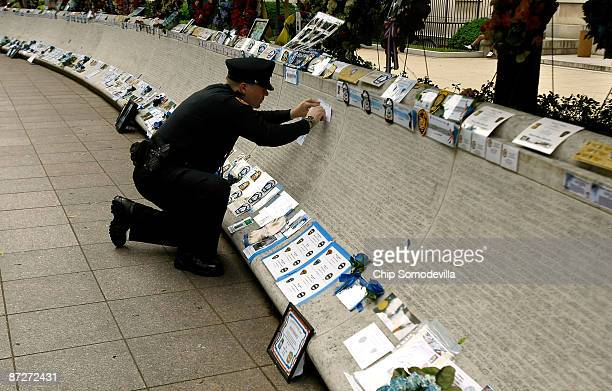 Memphis Tennessee Police Officer Nick Koonce makes a pencil rubbing from the memorial wall at the National Law Enforcement Officers Memorial May 15...